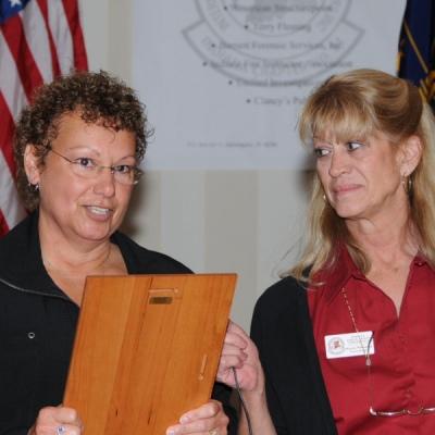 2009 Investigator of the Year Princess Spencer received the Investigator of the Year award from INIAAI Chapter President Karen Wilkinson.