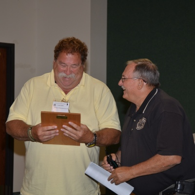 2012 Investigator of the Year Fred Daffer (L) receives his award from Robert Dean (R), Chief Investigator of the State Fire Marshall's Office.
