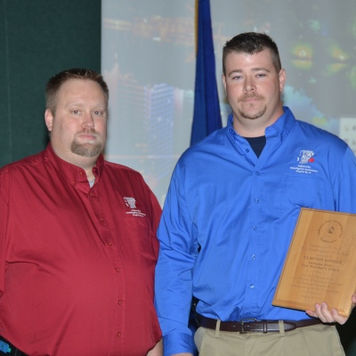 President Chad Ford (L) presenting Clayton Kinder (R) the 2013 Lawrence W. Tuck Investigator of the Year Award.