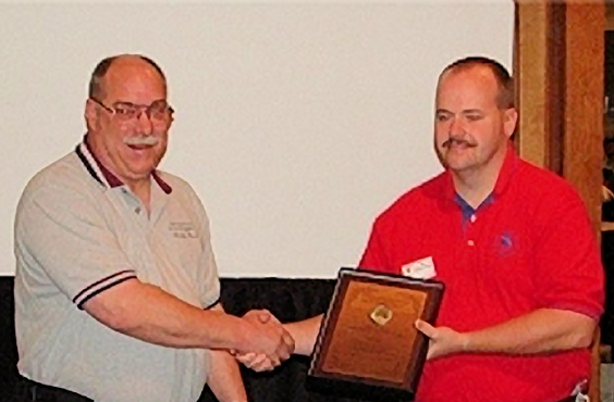 Jack Fetrow presents Steve Shand (right) of Shand Forensic Investigations with the 2017 Terry T. Fleming Lifetime Achievement Award.